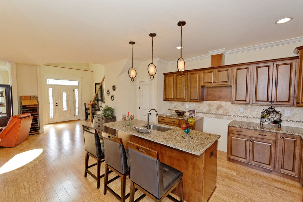 Mobern Lighting for a Traditional Kitchen with a Traditional Kitchen and Village at Shaker Creek by Viscusi Builders Ltd.