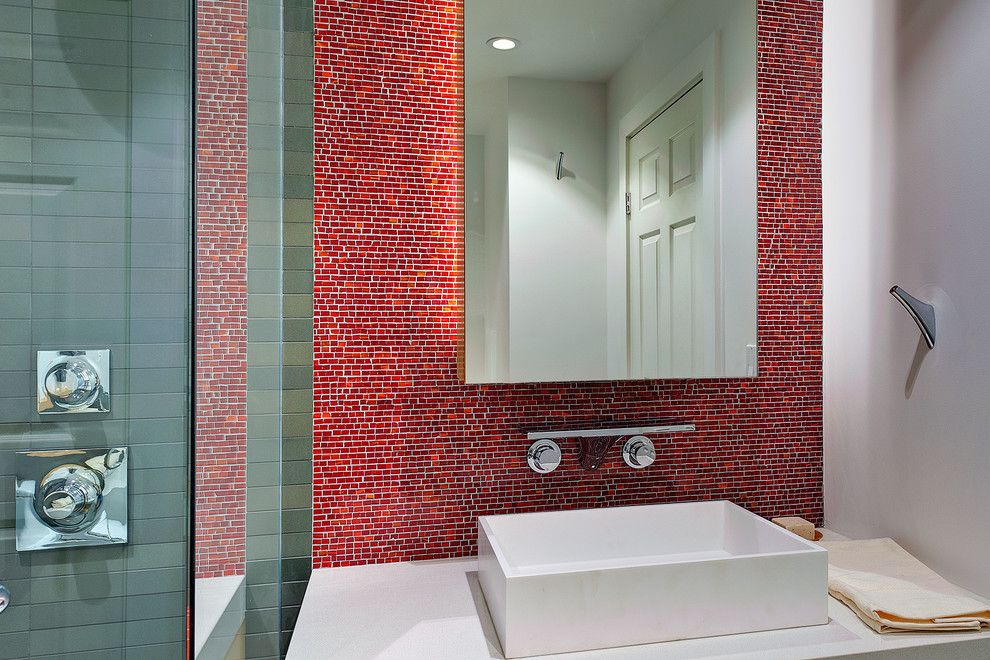 Nessen Lighting for a Modern Bathroom with a Bathroom Mirror and Concealed Lighting at the Backsplash Effect by Michael Tauber Architecture