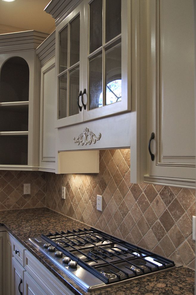 Oak Liquidators for a Traditional Kitchen with a Hardwood Floors and Creative Cabinets and Faux Finishes, Llc by Creative Cabinets and Faux Finishes. Llc