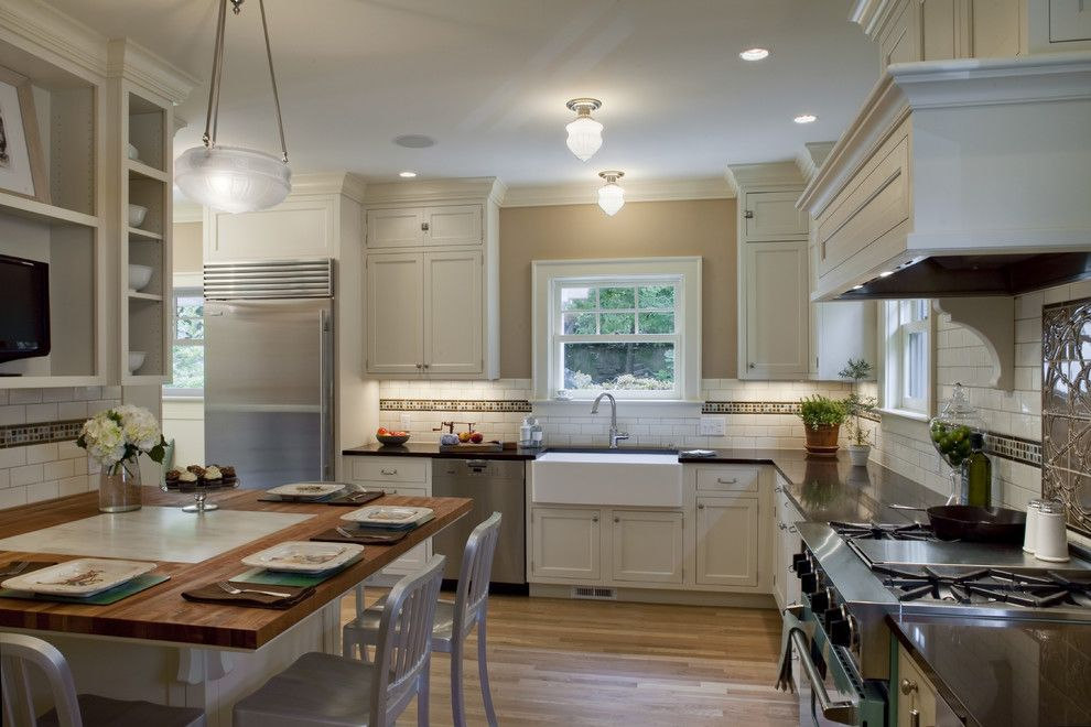 Peaceful Valley Farm Supply for a Traditional Kitchen with a Madrone Countertops with Marble Inset and 1920 Colonial Kitchen by Craftsman Design and Renovation