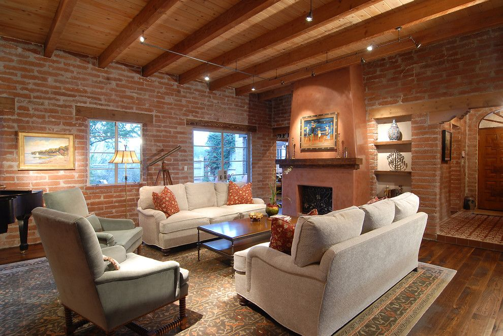 Potomac Valley Brick for a Southwestern Living Room with a Dark Wood Floor and Historic Adobe by Lisa Gildar Interior Spaces