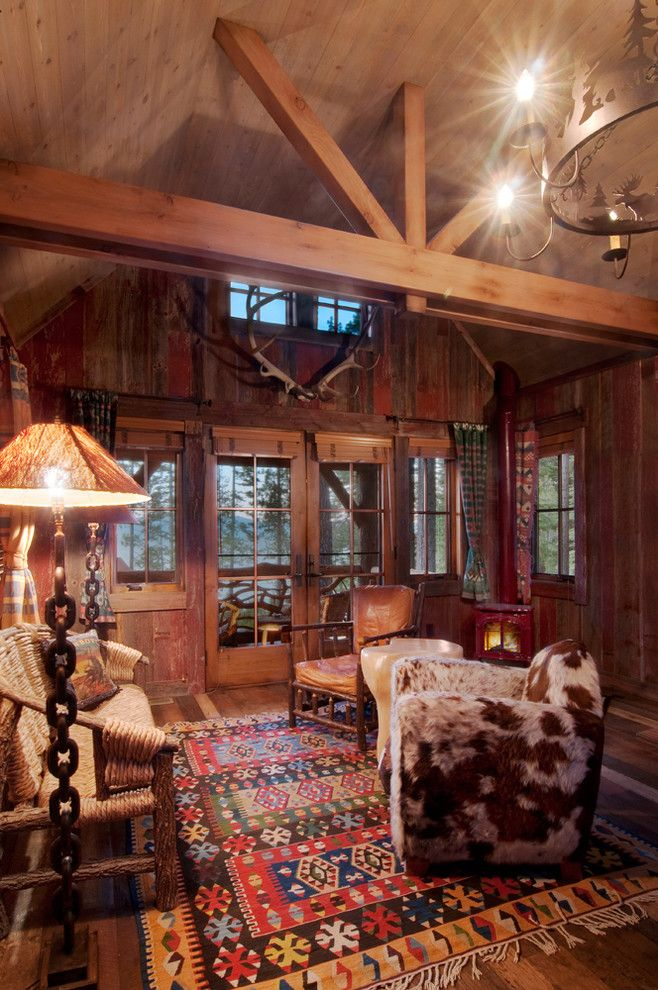 Rawhide Ranch for a Rustic Family Room with a Cowhide Chair and Sitting Area by Ward Young Architecture & Planning   Truckee, Ca