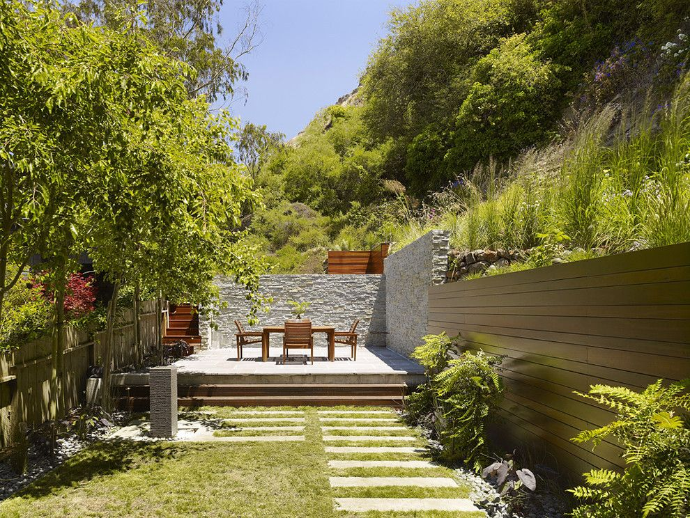Restaining Wood for a Modern Landscape with a Stone Wall and Cole Valley Hillside   John Maniscalco Architecture by John Maniscalco Architecture