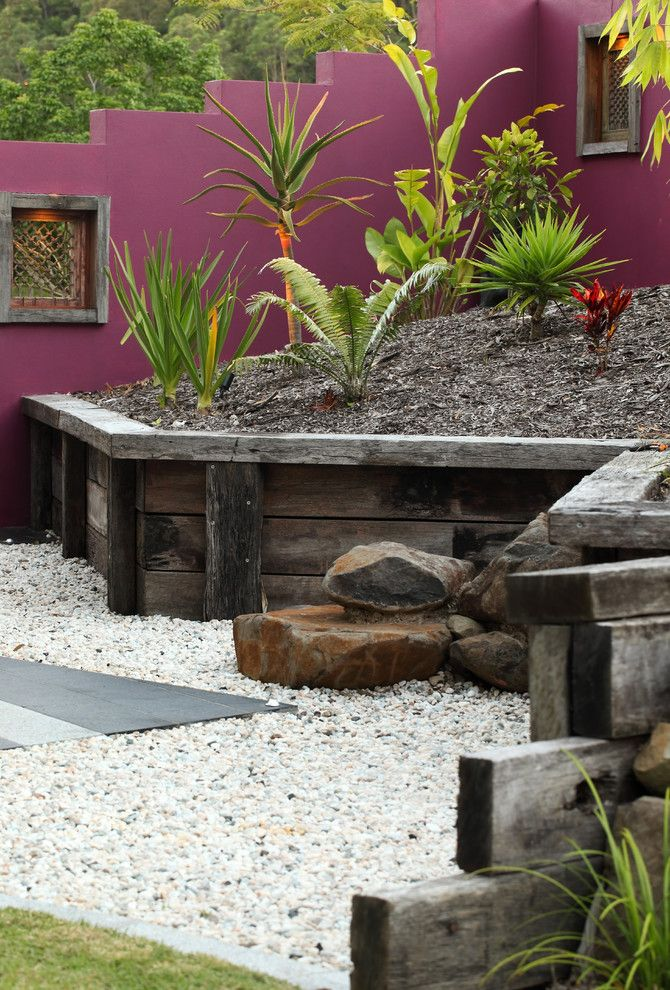 Restaining Wood for a Tropical Landscape with a Gravel and Buderim Meadows by Living Style Landscapes