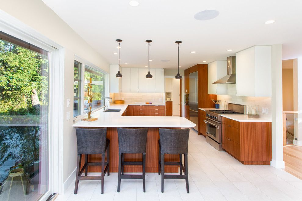 Sapele Wood for a Contemporary Kitchen with a Beige Backsplash and Hall Renovation by Cindy Ross Interior Design