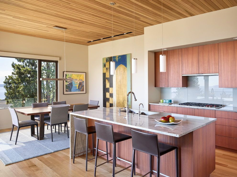 Sapele Wood for a Contemporary Kitchen with a Gray Dining Chairs and Gallery House by Deforest Architects