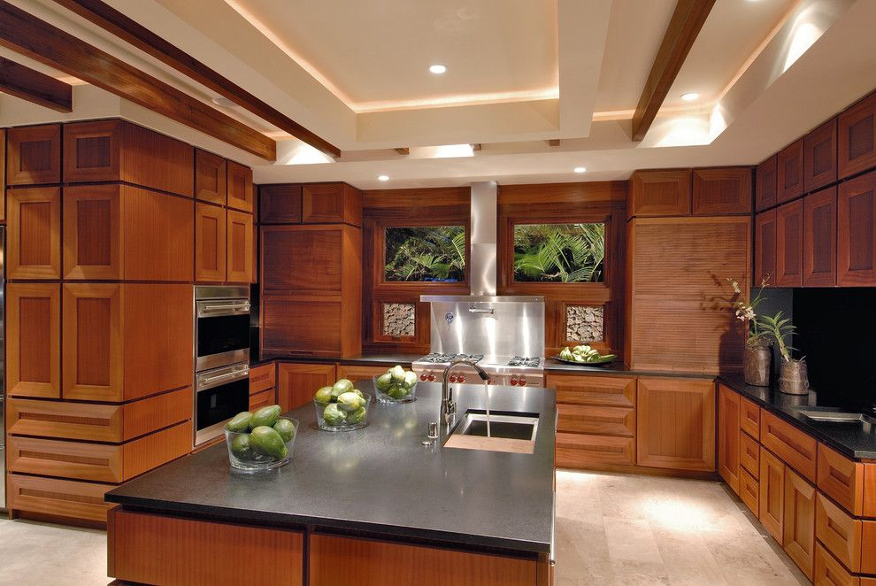 Sapele Wood for a Contemporary Kitchen with a Tray Ceiling and Ownby Design by Ownby Design