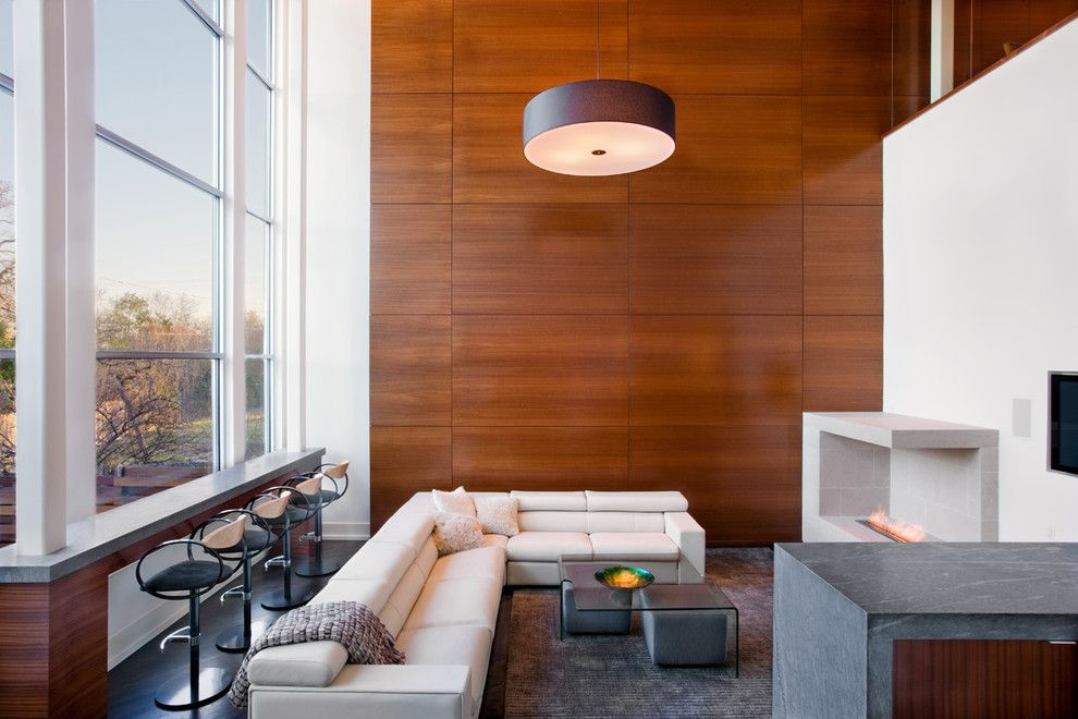 Sapele Wood for a Contemporary Living Room with a Built in and Contemporary Living Room by Dick Clark + Associates