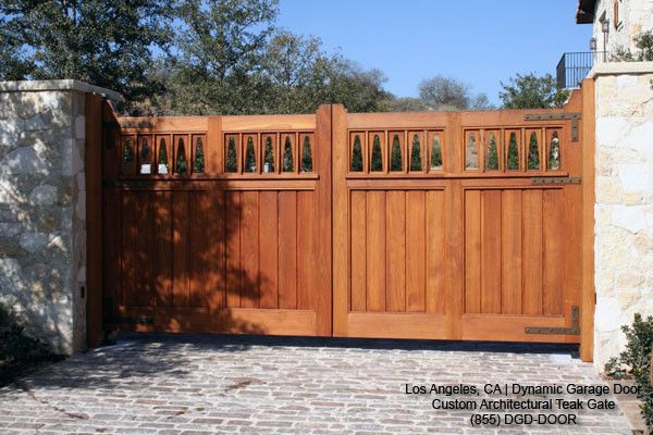 Schwing Electric for a Eclectic Exterior with a Garden Gates and Custom Designed Solid Teak Automatic Driveway Swing Gates by Dynamic Garage Door