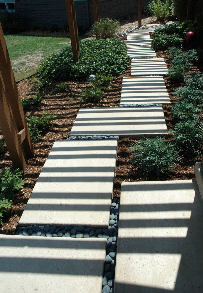 Soft Caress Mahonia for a Contemporary Landscape with a Concrete Sea Salt Finish and California Contempory in the Heart of the Midwest by Kingdom Landscape