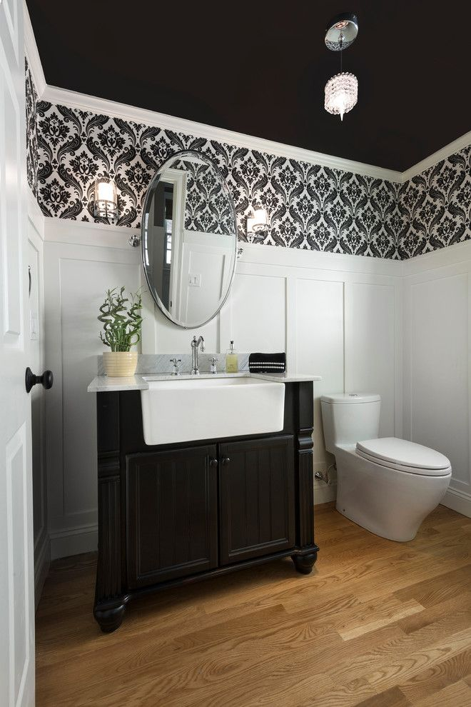 Southeastern Furniture for a Traditional Powder Room with a Oval Mirror and Hampshire Project by Haddad Hakansson Design Studio