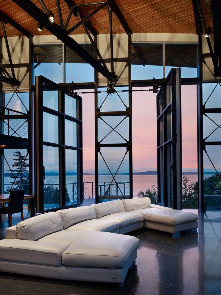 Speedy Auto Glass for a Industrial Living Room with a Tile Floor and Industrial Living Room by Lawrencearchitecture.com