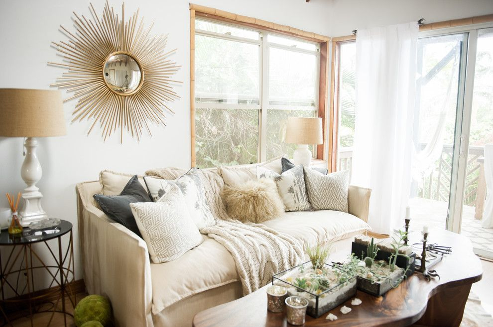 Sport Chalet La Canada for a Beach Style Living Room with a Round Mirror and My Houzz: Chic Boho Style for a Hawaii Apartment by Ashley Camper Photography