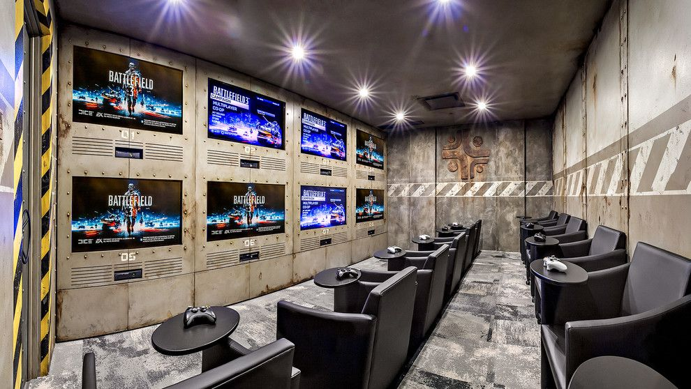 Stadium Lofts Anaheim for a Industrial Home Theater with a Recessed Lighting and Gaming Room by K&w Audio
