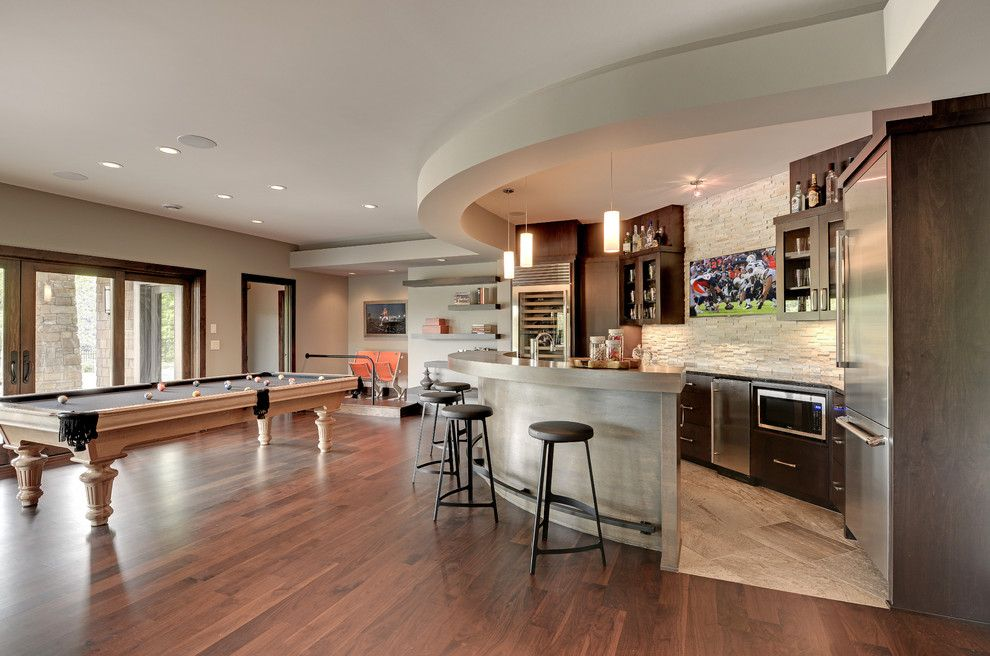 Stadium Lofts Anaheim for a Transitional Family Room with a Soft Gray Walls and Transitional Family Room by Eskuche.com