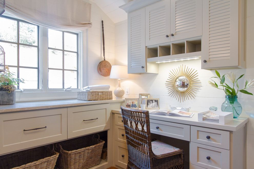 Suzanne Kasler for a Traditional Laundry Room with a Sunburst Mirror and Buckhead Residence by Jessica Bradley Interiors