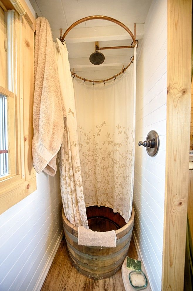 Tankless vs Tank Water Heater for a Rustic Bathroom with a Paneled Walls and Our Tiny Tack House by the Tiny Tack House