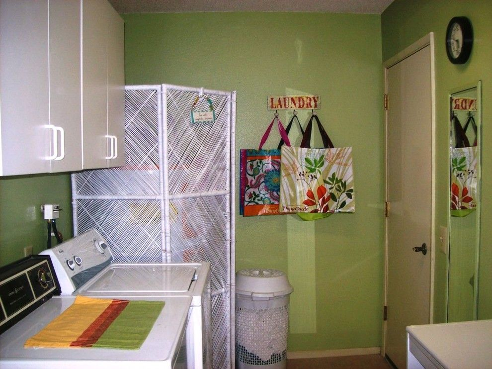 Tankless vs Tank Water Heater for a Traditional Laundry Room with a Traditional and Jude Reed by Freebirdliving