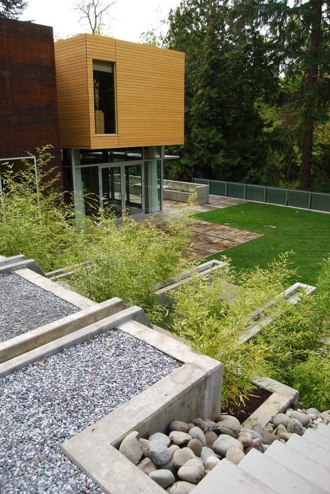 Tidewater Property Management for a Contemporary Landscape with a Lawn and Shwa by Samuel H. Williamson Associates