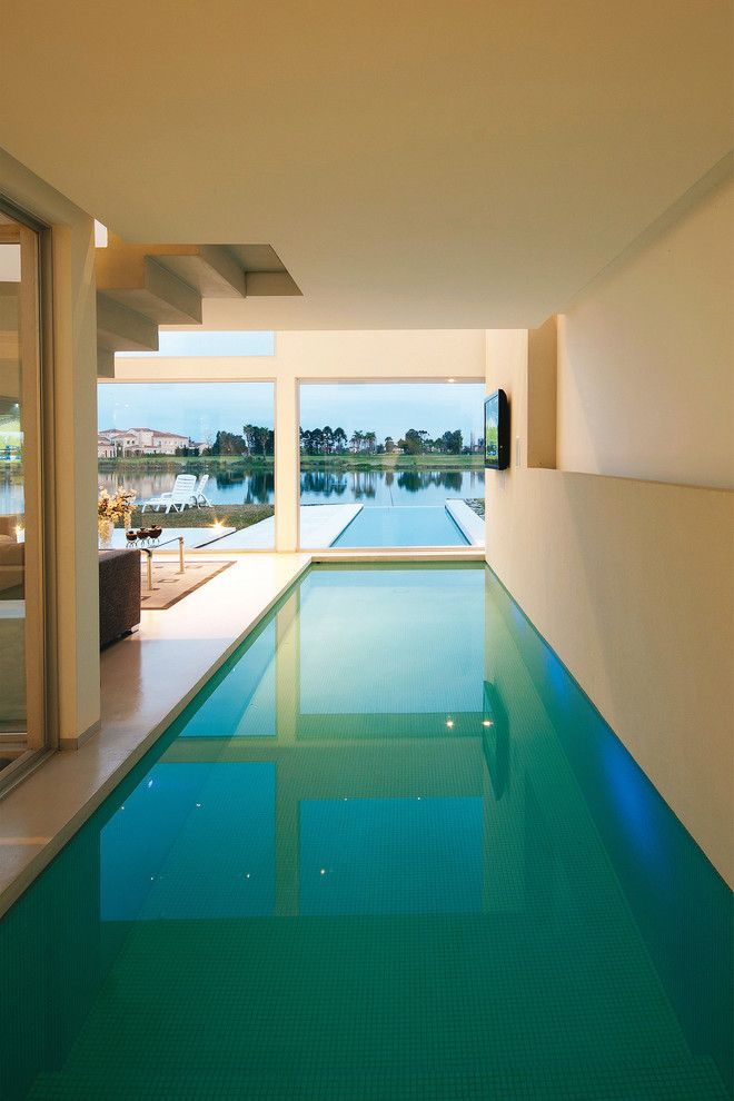 Tidewater Property Management for a Contemporary Pool with a Modern Staircase and Vanguarda Architects by Vanguarda Architects