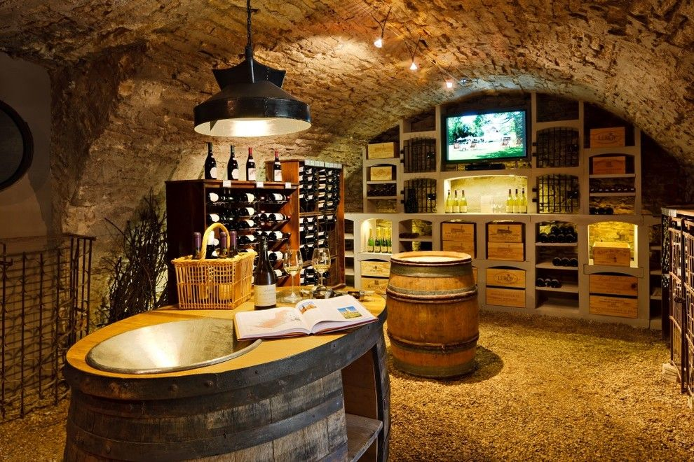 Wine Cellar Los Gatos for a Rustic Wine Cellar with a Barrel Vault Ceiling and Wine Cellar of Burgundy Limestone by Vinis BMC Production