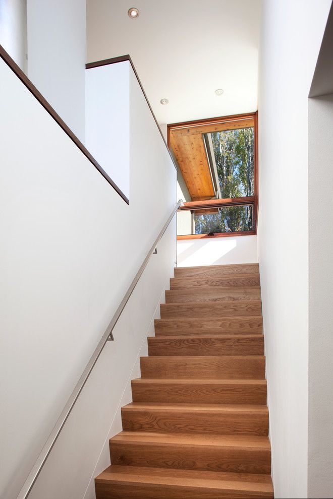 2700k Light for a Contemporary Staircase with a Stainless Steel Handrail and Stairs by Ohashi Design Studio