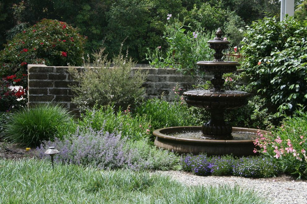 2700k Light for a Mediterranean Landscape with a Fountain and 1900 Farm House by Pat Brodie Landscape Design