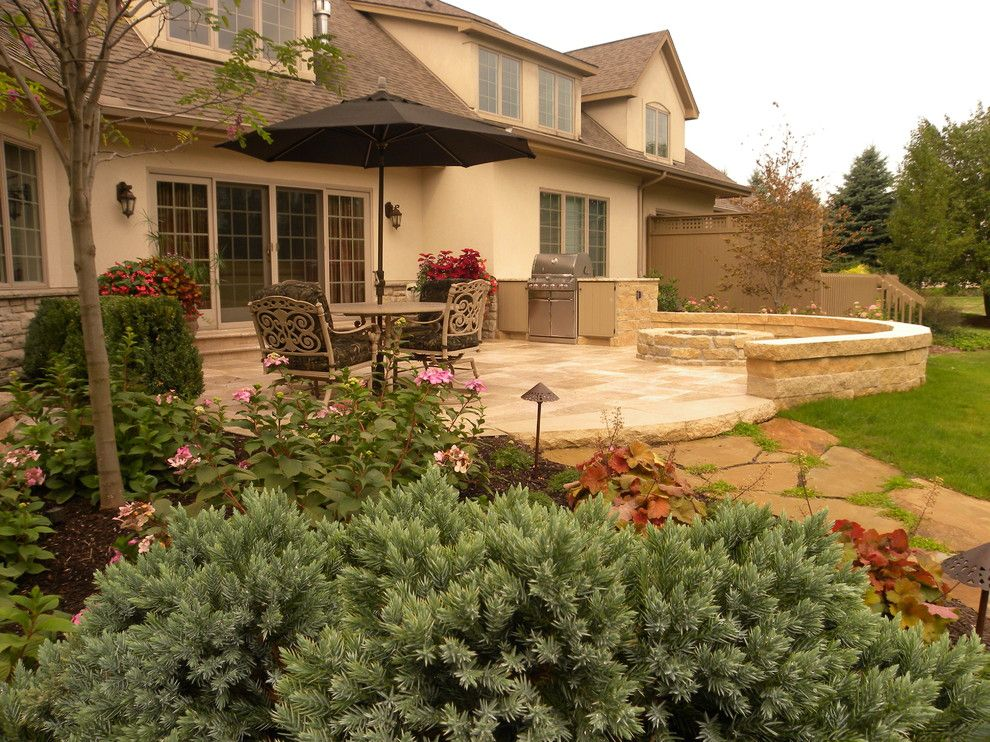 2700k Light for a Traditional Patio with a Seat Wall and Hardscaping Back Yard Patio by Smalls Landscaping