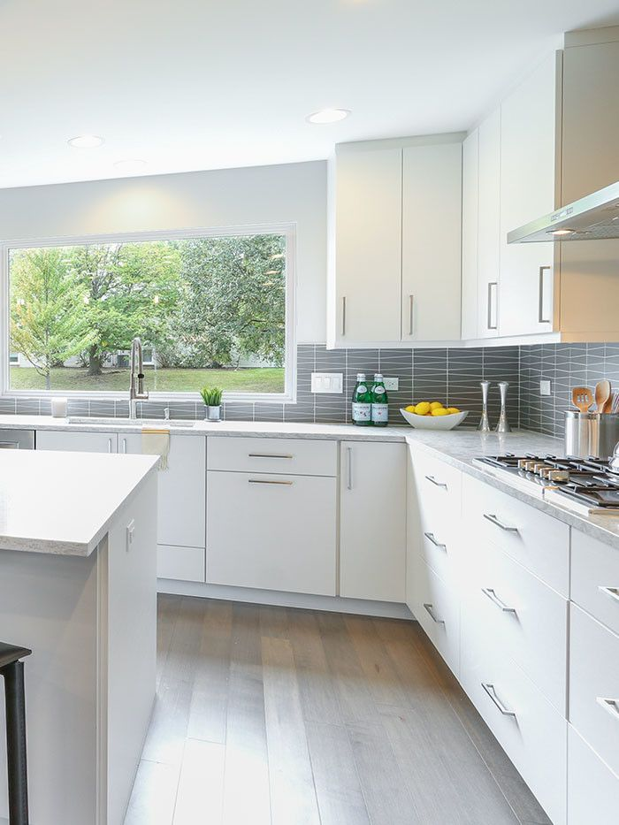 60035 for a Contemporary Kitchen with a Large Island and Highland Park Kitchen Remodel by Prestige Renovations