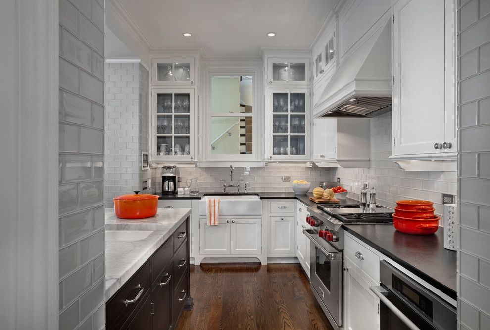 9x18 for a Transitional Kitchen with a Bin Pulls and Hyde Park Renovation by Tom Stringer Design Partners