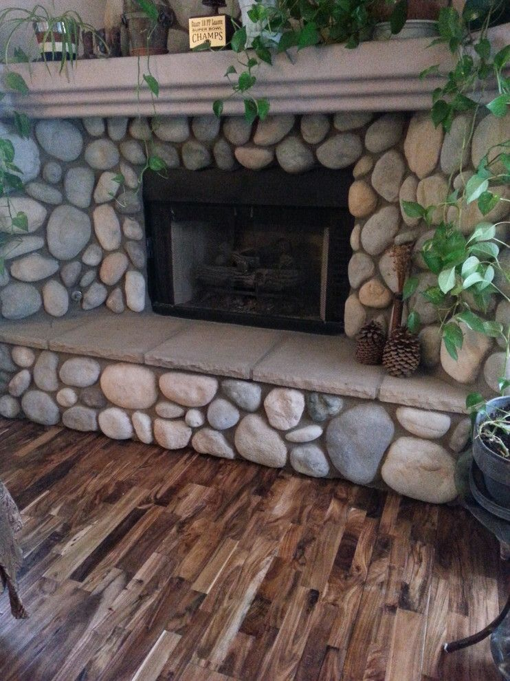 Abbey Flooring for a Rustic Living Room with a Large Fireplace and Hardwood by Prescott'S Abbey Flooring and Design