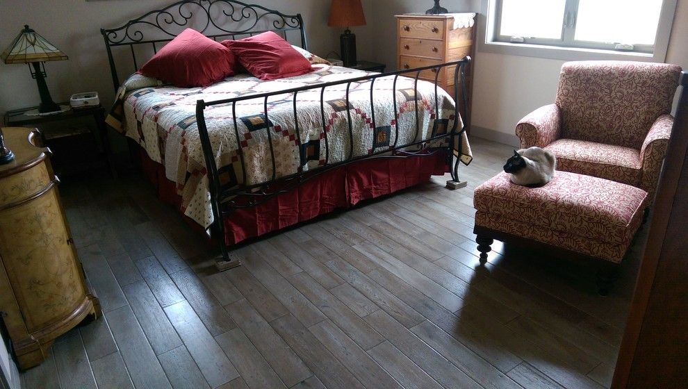 Abbey Flooring for a Traditional Bedroom with a Gray Hardwood and Bedrooms by Seland's Abbey Flooring Center