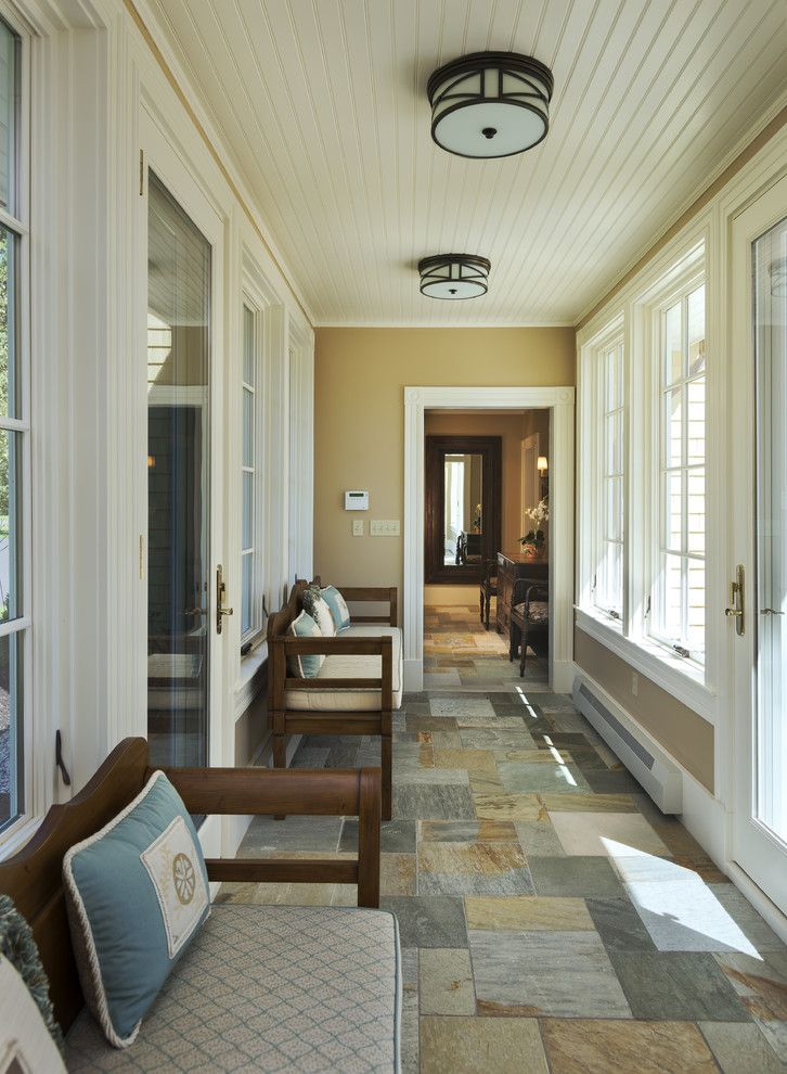 Abbey Flooring for a Traditional Entry with a Stone Tile Floor and Traditional Entry by Whittenarchitects.com