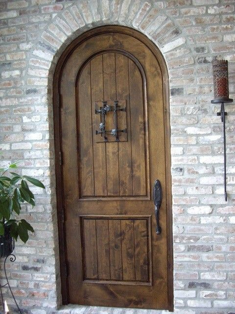 Acme New Orleans for a Traditional Wine Cellar with a Custom Wine Cellar Door and Knotty Alder Custom Wine Cellar Door La in an Early American Stain by Wine Cellar Specialists