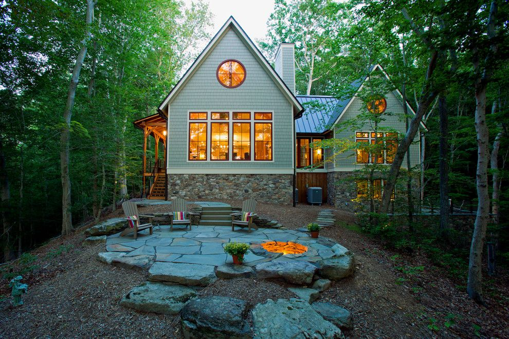 Adirondack Camp for a Rustic Exterior with a Natural Stone and Lakefront Timber Frame Home and Pavillions by Kohlmark Architects and Builders