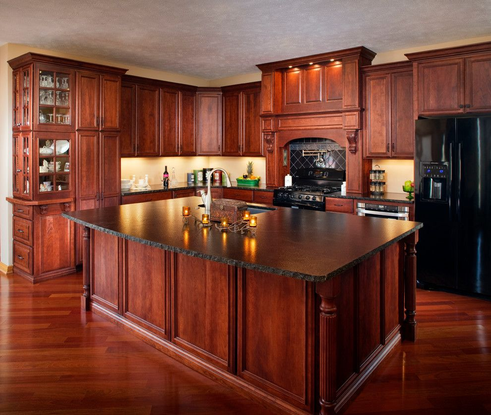 Adorne for a Traditional Kitchen with a Cherry and Adorned Traditional Cherry by Cabinet Factory Outlet Plus