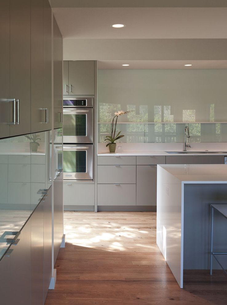 Aireco Supply for a Modern Kitchen with a Wood Flooring and Foxtree Cove by Webber + Studio, Architects
