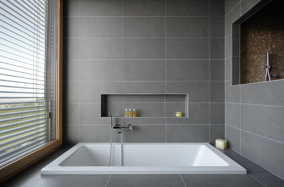Alcove Definition for a Contemporary Bathroom with a Large Window and Casa Magnanelli by Manuel Benedikter Architetto