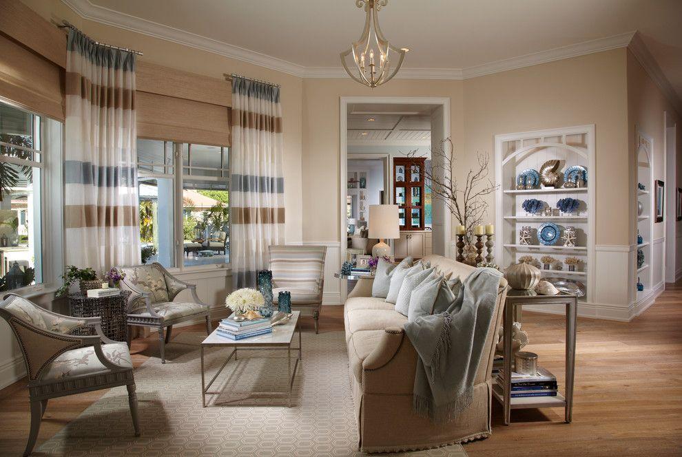 Alexa Hampton for a Tropical Family Room with a Throw and Coastal Living | Davis Island | Interior Design by Studio M Interior Design