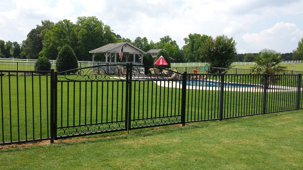 Allied Fence for a Traditional Exterior with a Black Wrought Iron Fence and Double Scroll Gate by Allied Fence Co