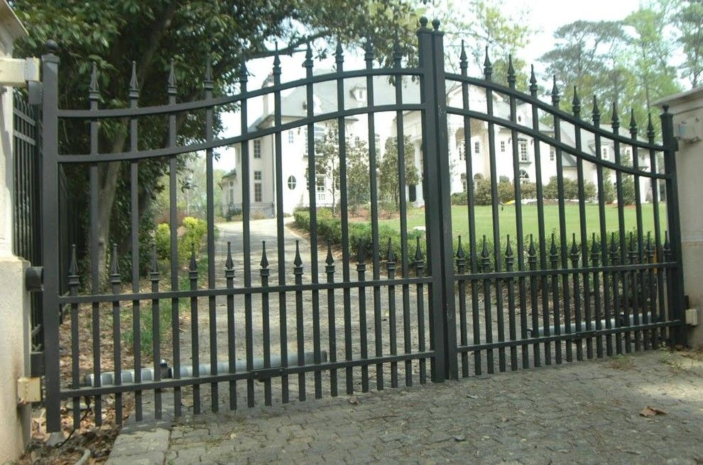 Allied Fence for a Traditional Exterior with a Exterior Stone Siding and Estate Gates by Allied Fence Co