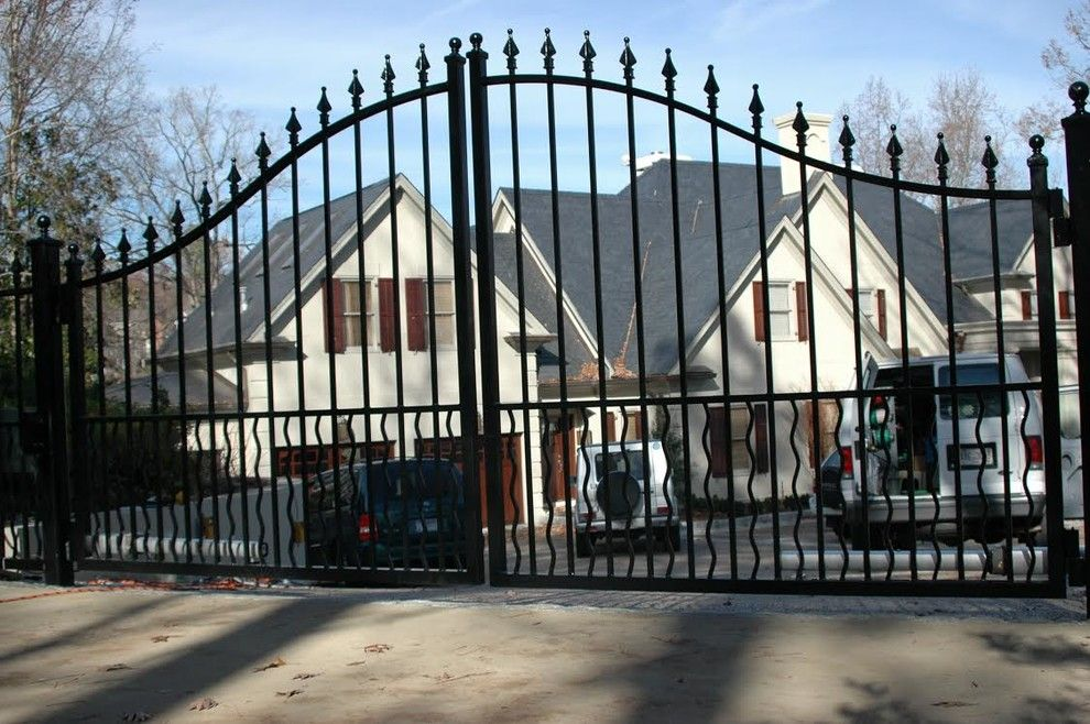 Allied Fence for a Traditional Exterior with a Wrought Iron Arched Gate and Estate Gates by Allied Fence Co