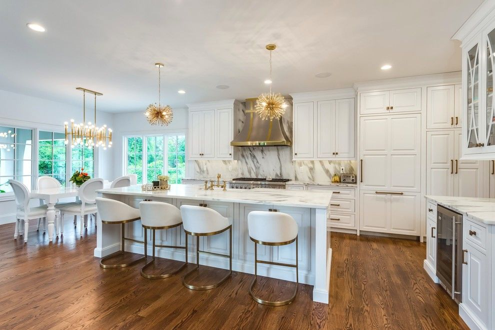 Alltex for a Transitional Kitchen with a White Leather Barstools and White + Brass Fashion-Forward Kitchen by Beck/Allen Cabinetry