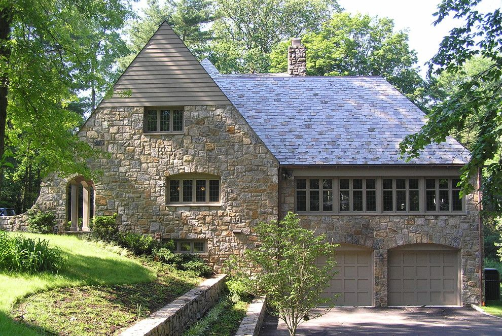 Alpine Snow Guards for a Traditional Exterior with a Cross Gable Roof and Stone Manor House in Scarsdale, Ny by Hamlin Goldreyer Architects