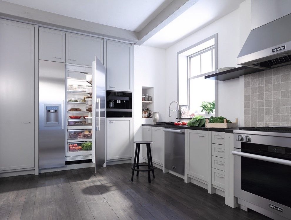 American Exteriors for a Modern Kitchen with a Gray Backsplash and Miele by Miele Appliance Inc