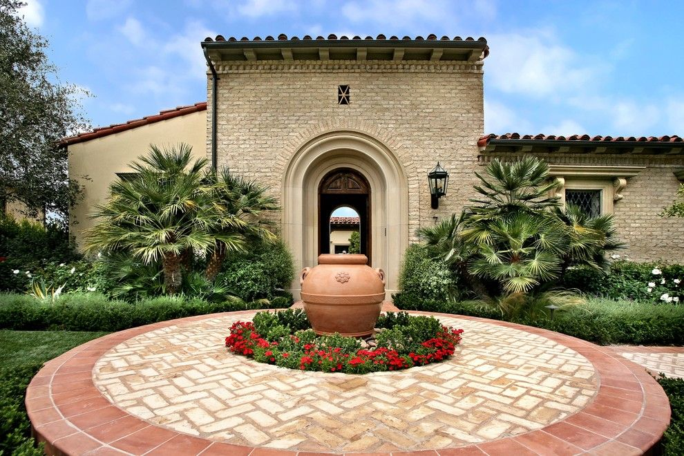 Amli South Shore for a Mediterranean Landscape with a Brick and Ams Landscape Design Studios by Ams Landscape Design Studios, Inc.