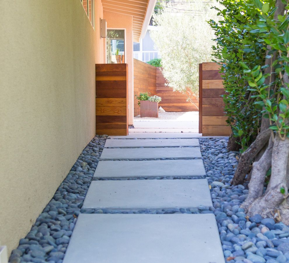Angelus Block for a Contemporary Landscape with a Pipe Wood Deck and Modern Minimalist by Dp Environments