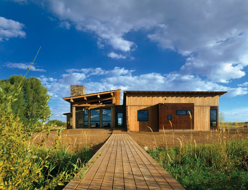 Appalachian Log Homes for a Rustic Exterior with a Glass Doors and New Fork Social Club by Carney Logan Burke Architects