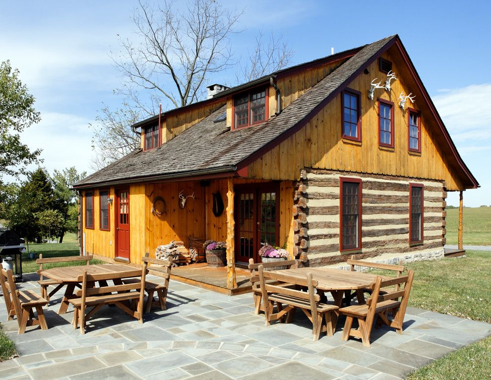 Appalachian Log Homes for a Rustic Exterior with a Meadow and Front by KohlMark Architects and Builders
