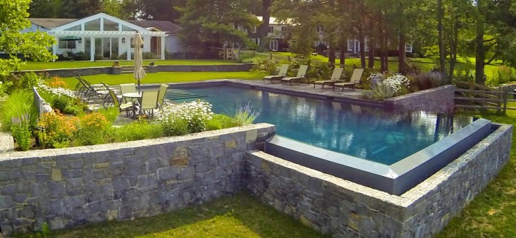 Aquatech for a Traditional Pool with a Slate Tile and Infinity Edge Elements - New Castle, DE by Armond Aquatech Pools